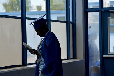 Destiny Kelly finds a quiet place to read a card at the Encinal High School 60th Graduating Class: Class of 2016 Commencement Ceremony at Encinal High School in Alameda, Calif., on Friday, June 17, 2016. (Dan Honda/Bay Area News Group)