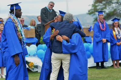 Graduates hug a retiring staff member during the Encinal High School 60th Graduating Class: Class of 2016 Commencement Ceremony at Encinal High School in Alameda, Calif., on Friday, June 17, 2016. (Dan Honda/Bay Area News Group)