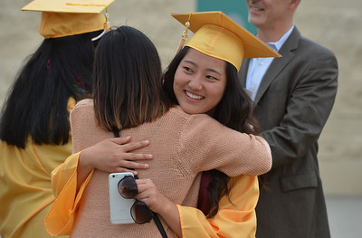 Joanne Park gets a hug at Alameda High School's Class of 2016 Commencement Ceremony at Thompson Field in Alameda, Calif., on Friday, June 17, 2016. (Dan Honda/Bay Area News Group)