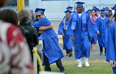 A graduate breaks ranks as they march into the stadium at the Encinal High School 60th Graduating Class: Class of 2016 Commencement Ceremony at Encinal High School in Alameda, Calif., on Friday, June 17, 2016. (Dan Honda/Bay Area News Group)