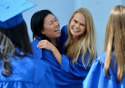 Yi Yuan, left, and Oda Hove, right, share a hug and a laugh at the Encinal High School 60th Graduating Class: Class of 2016 Commencement Ceremony at Encinal High School in Alameda, Calif., on Friday, June 17, 2016. (Dan Honda/Bay Area News Group)