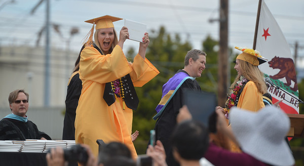 An excited graduate reacts as she receives her diploma at Alameda High School's Class of 2016 Commencement Ceremony at Thompson Field in Alameda, Calif., on Friday, June 17, 2016. (Dan Honda/Bay Area News Group)
