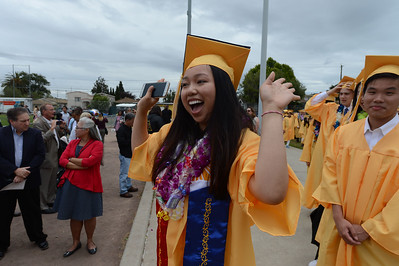 Judith Dimalanta waves to friends and family at Alameda High School's Class of 2016 Commencement Ceremony at Thompson Field in Alameda, Calif., on Friday, June 17, 2016. (Dan Honda/Bay Area News Group)