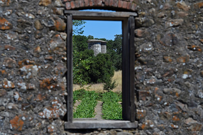Two large cement block silos constructed between 1912 and 1915 stand over 40 feet tall photographed through a window at Jack London State Historic Park in Glen Ellen, Calif., on Monday, June 27, 2016. (Jose Carlos Fajardo/Bay Area News Group)