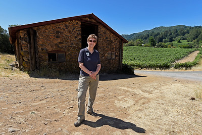 Director of Programs and volunteer management Susan St. Marie stands in front of the Stallion Barn built in 1914 at Jack London State Historic Park in Glen Ellen, Calif., on Monday, June 27, 2016. (Jose Carlos Fajardo/Bay Area News Group)
