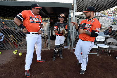 Pittsburg Diamonds designated hitter Jose Canseco (33) chats with catcher Tyler Norgren (6), from left, and pitcher Justin Lawrence (22) before playing against the Sonoma Stompers at Winter Chevrolet Stadium in Pittsburg, Calif., on Thursday, Aug. 4, 2016. (Jose Carlos Fajardo/Bay Area News Group)