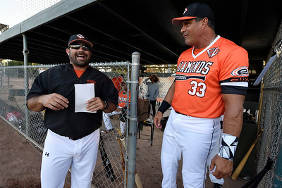 Pittsburg Diamonds manager Aaron Miles shares a laugh with designated hitter Jose Canseco (33) before playing against the Sonoma Stompers at Winter Chevrolet Stadium in Pittsburg, Calif., on Thursday, Aug. 4, 2016. (Jose Carlos Fajardo/Bay Area News Group)