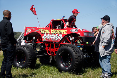 """Shane """"Skull Crusher"""" Plato, 8, billed as the world's youngest mini-monster truck driver, climbs out of his rig at the Pacific Coast Dream Machines Show, Sunday morning, April 24, 2016, at the Half Moon Bay Airport in Moss Beach, Calif. (Karl Mondon/Bay Area News Group)"""