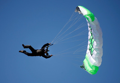 A skydiver banks a hard turn arriving at the Pacific Coast Dream Machines Show, Sunday morning, April 24, 2016, after jumping from a Douglas C-47 Skytrain flying over the the Half Moon Bay Airport in Moss Beach, Calif. (Karl Mondon/Bay Area News Group)