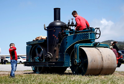 Tiantian Shan, 7, of Dublin, Calif., covers his ears as Eli Mosher threatens to blow the whistle on a 1924 Buffalo Springfield steamroller featured at the Pacific Coast Dream Machines Show, Sunday morning, April 24, 2016, at the Half Moon Bay Airport in Moss Beach, Calif. Owned by the Roots of Motive Power organization, the steamroller came from Willits, Calif., presumably on a flat bed truck, to join the 26th annual show. (Karl Mondon/Bay Area News Group)