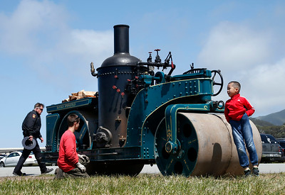 Tiantian Shan, 7, of Dublin, Calif., jumps in front of a 1924 Buffalo Springfield steamroller that Eli Mosher is tending to at the Pacific Coast Dream Machines Show, Sunday morning, April 24, 2016, at the Half Moon Bay Airport in Moss Beach, Calif. Owned by the Roots of Motive Power organization, the steamroller came from Willits, Calif., presumably on a flat bed truck, to join the 26th annual show. (Karl Mondon/Bay Area News Group)