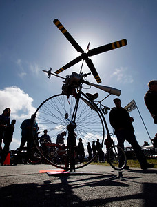 A pedal copter draws the curious at the Pacific Coast Dream Machines Show, Sunday morning, April 24, 2016, at the Half Moon Bay Airport in Moss Beach, Calif. The whimsical machine, owned by Ken Partney of Santa Paula, was one of thousands of mechanical marvels on display during the show's 26th annual incarnation. (Karl Mondon/Bay Area News Group)