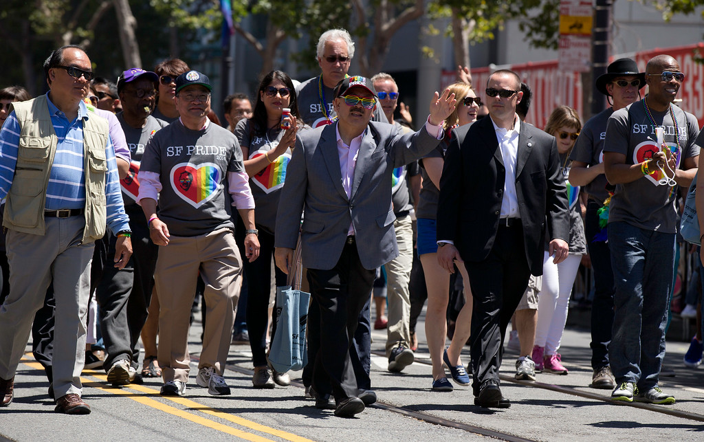 . Sporting a pair of rainbow sunglasses, San Francisco Mayor Ed Lee waves to the crowd at the 44th annual San Francisco Pride Parade, Sunday, June 29, 2014 on Market Street in San Francisco. (D. Ross Cameron/Bay Area News Group)