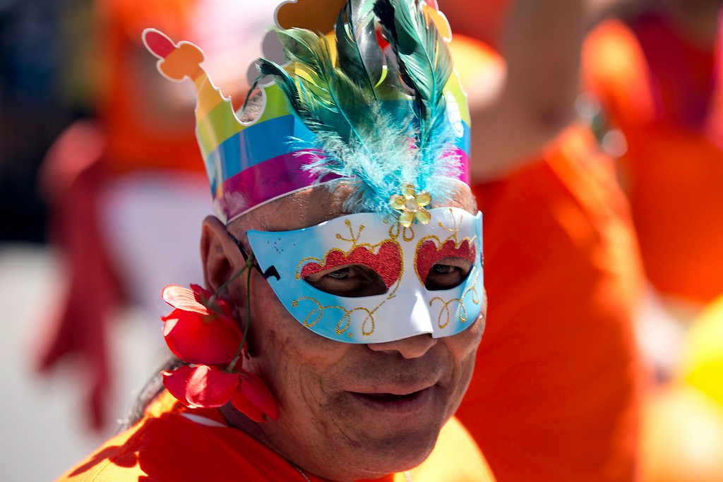 . An unidentified man, sporting flowers and rainbow crown, marches the route at the 44th annual San Francisco Pride Parade, Sunday, June 29, 2014 on Market Street in San Francisco. (D. Ross Cameron/Bay Area News Group)