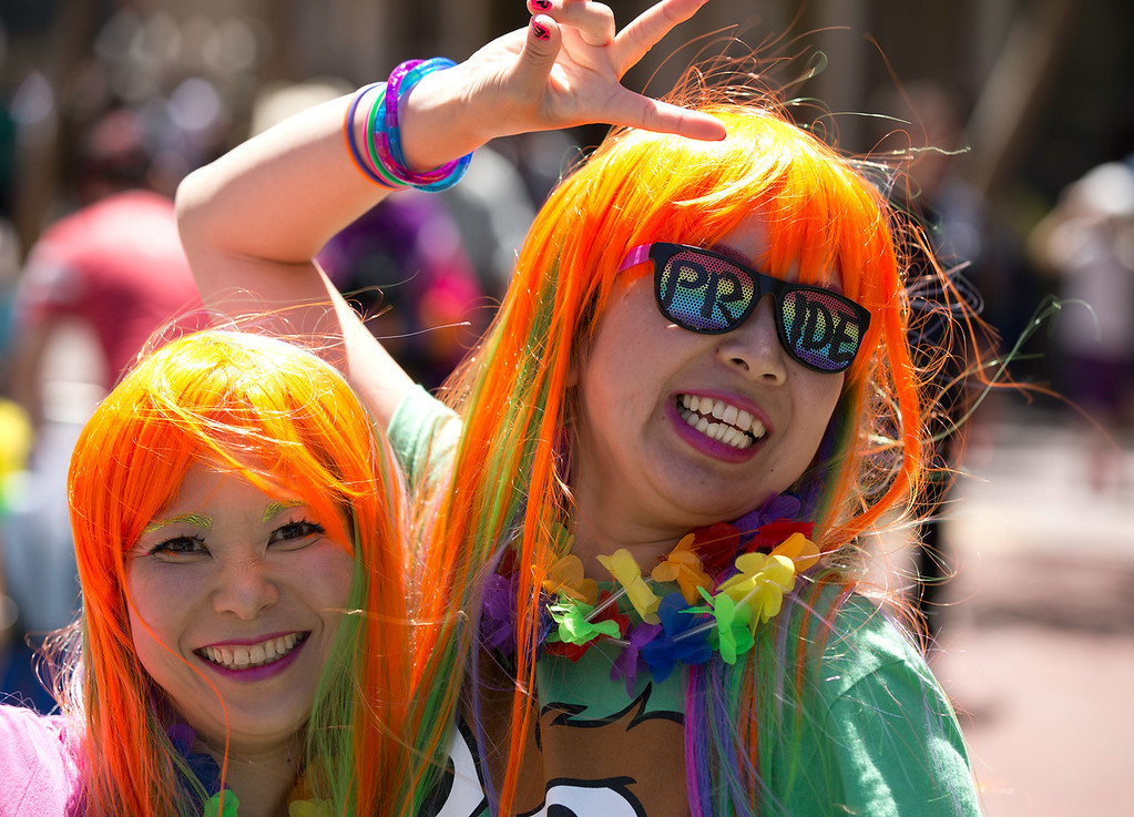 . Noriko Hasegawa, left, and Hiromi Harada of San Francisco enjoy themselves at the 44th annual San Francisco Pride Parade, Sunday, June 29, 2014 on Market Street in San Francisco. (D. Ross Cameron/Bay Area News Group)