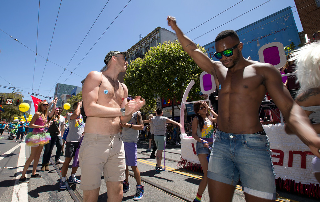 . Unidentified men dance to the beat as they march in the 44th annual LGBT Pride parade, Sunday, June 29, 2014 on Market Street in San Francisco. (D. Ross Cameron/Bay Area News Group)