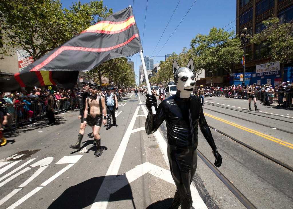 . An unidentified leather afficionado walks the route at the 44th annual San Francisco Pride Parade, Sunday, June 29, 2014 on Market Street in San Francisco. (D. Ross Cameron/Bay Area News Group)