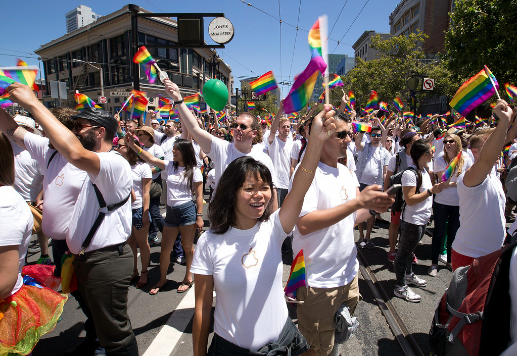 . A contingent of thousands of Apple employees march waving rainbow flags at the 44th annual LGBT Pride parade, Sunday, June 29, 2014 on Market Street in San Francisco. (D. Ross Cameron/Bay Area News Group)