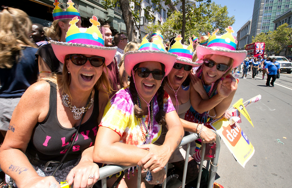 . Unidentified spectators with matching hats line the route at the 44th annual LGBT Pride parade, Sunday, June 29, 2014 on Market Street in San Francisco. (D. Ross Cameron/Bay Area News Group)