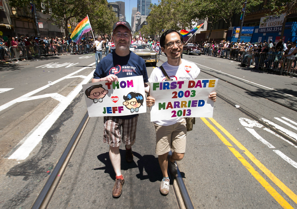 . Same-sex spouses Thom, left, and Jeff of Daly City, Calif. marched with a group of gay marriage advocates at the 44th annual San Francisco Pride Parade, Sunday, June 29, 2014 on Market Street in San Francisco. (D. Ross Cameron/Bay Area News Group)