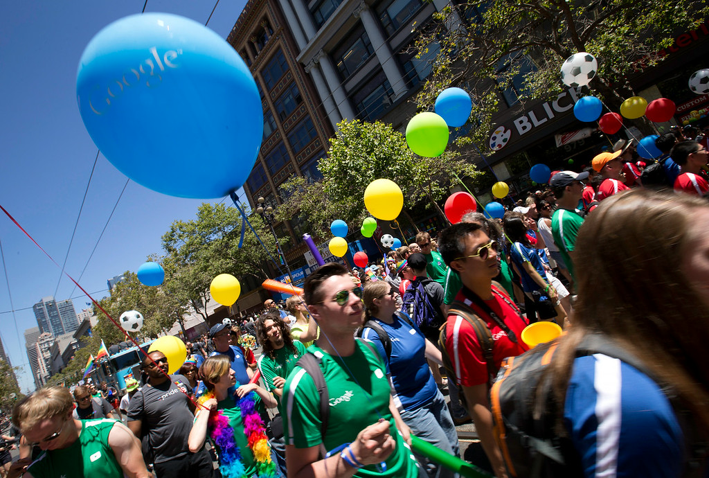 . A gaggle of Google employees march along Market Street at the 44th annual San Francisco Pride Parade, Sunday, June 29, 2014 in San Francisco. (D. Ross Cameron/Bay Area News Group)
