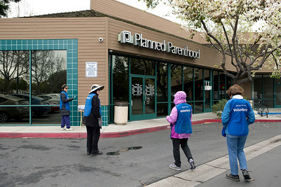 Planned Parenthood Health Center volunteers gather outside the center in Mountain View, Calif., on Thursday., Feb.6, 2014.   (LiPo Ching/Bay Area News Group)