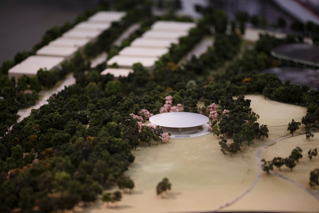 . A model of Apple\'s proposed new campus includes a theater for meetings and presentations. The plan will go up for a final vote before the Cupertino City Council on Oct. 15. The model was photographed at Apple\'s office located at the proposed new campus site on Oct. 10, 2013 in Cupertino. (Dai Sugano/Bay Area News Group)