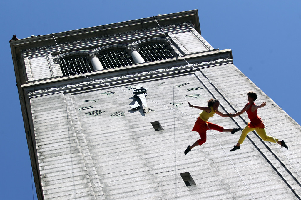 . Dancers, from left, Amelia Rudolph founder and artistic director and Meghan Mullin with the BANDALOOP company perform an aerial dance on UC Berkeley�s Jane K. Sather Campanile in Berkeley, Calif., Saturday, April 18, 2015. (Anda Chu/Bay Area News Group)