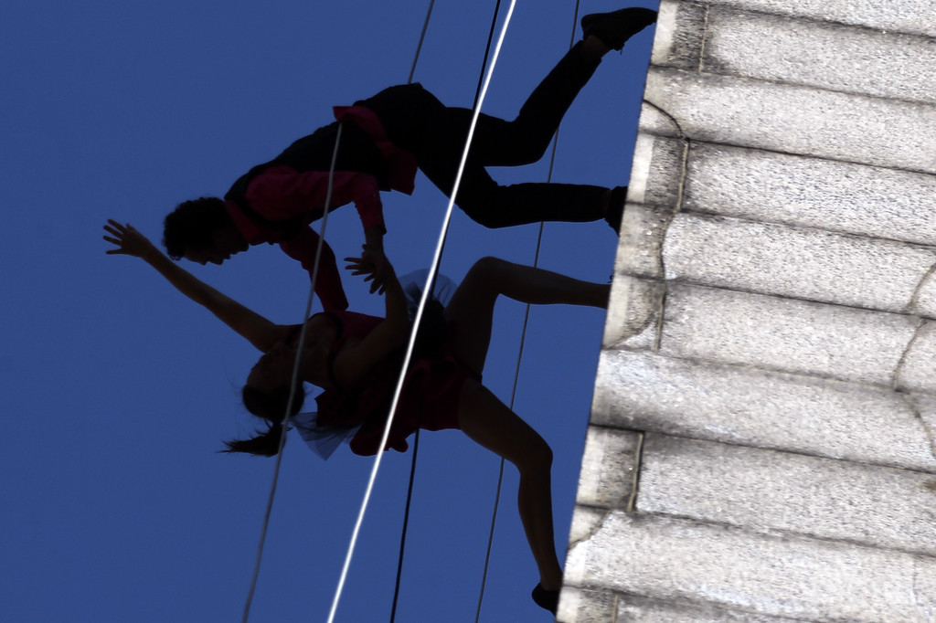 . Jessica Swason and Roel Seeber dancers with the BANDALOOP company perform an aerial dance on UC Berkeley�s Jane K. Sather Campanile in Berkeley, Calif., Saturday, April 18, 2015. (Anda Chu/Bay Area News Group)