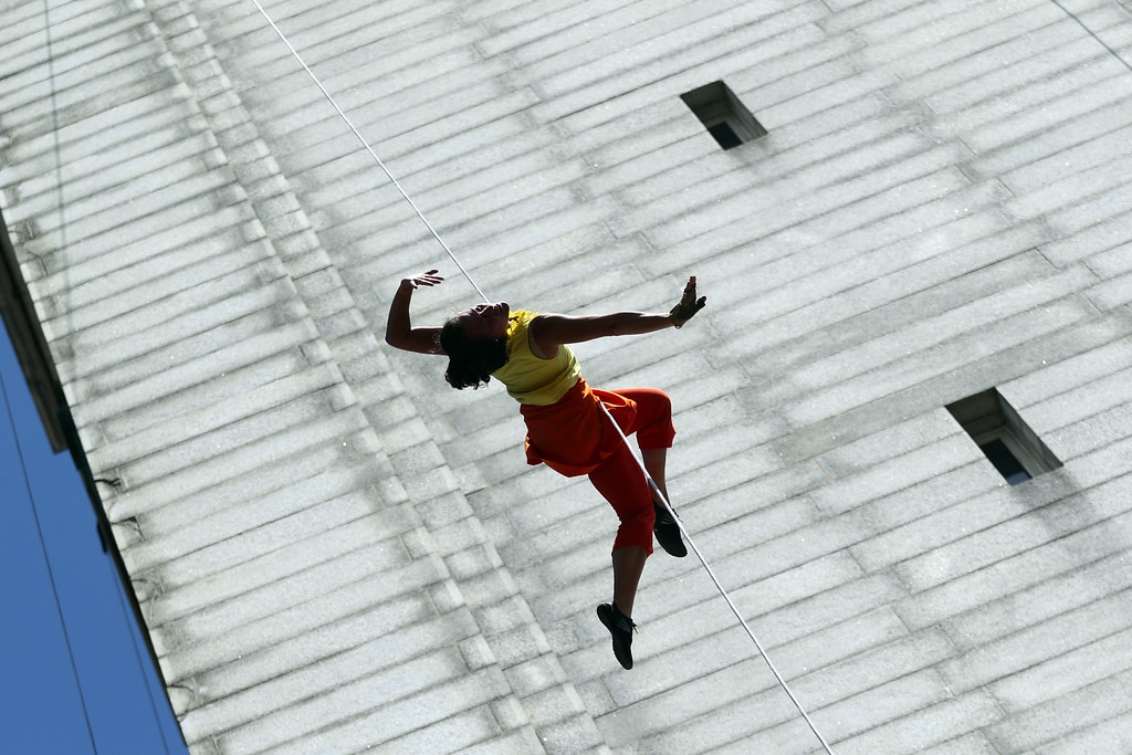 . Amelia Rudolph founder and artistic director with the BANDALOOP company performs an aerial dance on UC Berkeley�s Jane K. Sather Campanile in Berkeley, Calif., Saturday, April 18, 2015. (Anda Chu/Bay Area News Group)