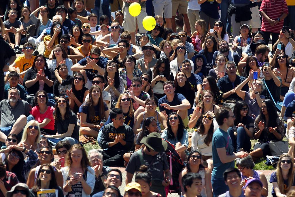 . Spectators watch the BANDALOOP company perform an aerial dance on UC Berkeley�s Jane K. Sather Campanile in Berkeley, Calif., Saturday, April 18, 2015. (Anda Chu/Bay Area News Group)