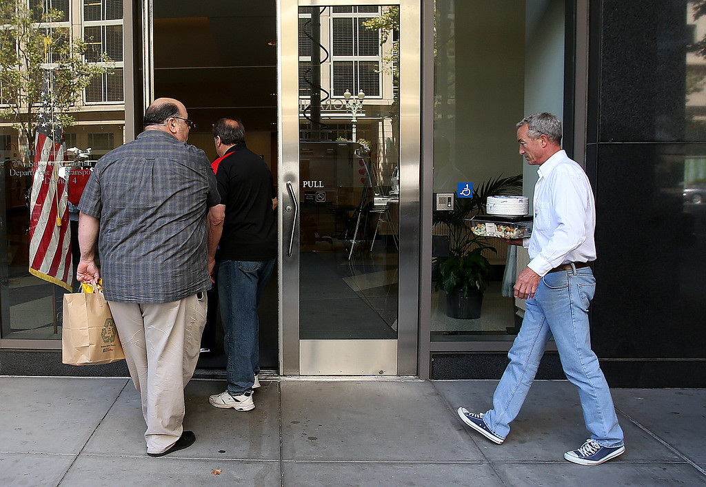 . Lunch is brought in for negotiators during talks with BART mangament and unions at Caltrans offices on Sunday, Aug. 4, 2013, in Oakland, Calif.  (Aric Crabb/Bay Area News Group)