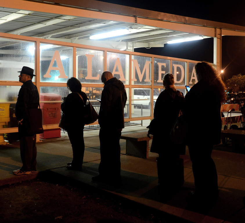 . Commuters wait in long lines at the Alameda Main Street Ferry Terminal in Alameda, Calif., on Friday, Oct. 18, 2013. BART workers went on strike at midnight after contract talks broke down, forcing commuters to find alternative ways to get to around the Bay Area. (Dan Honda/Bay Area News Group)
