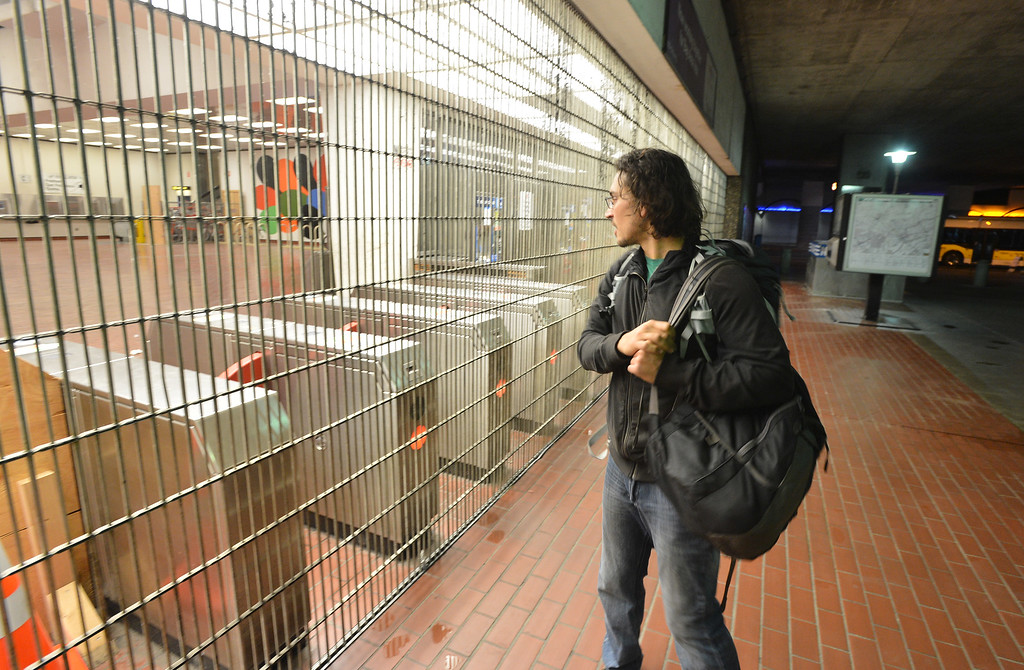 . Needing to get to the Oakland airport, Oakland resident Eka Joti finds the MacArthur BART station closed as workers at the transit agency go on strike in Oakland, Calif., on Friday, Oct. 18, 2013. (Kristopher Skinner/Bay Area News Group)