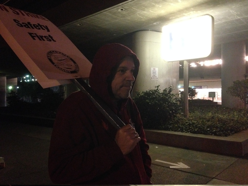 . BART train operator trainer Mike Patchen pickets early Friday at the MacArthur BART station in Oakland.  (Kristopher Skinner/Bay Area News Group)