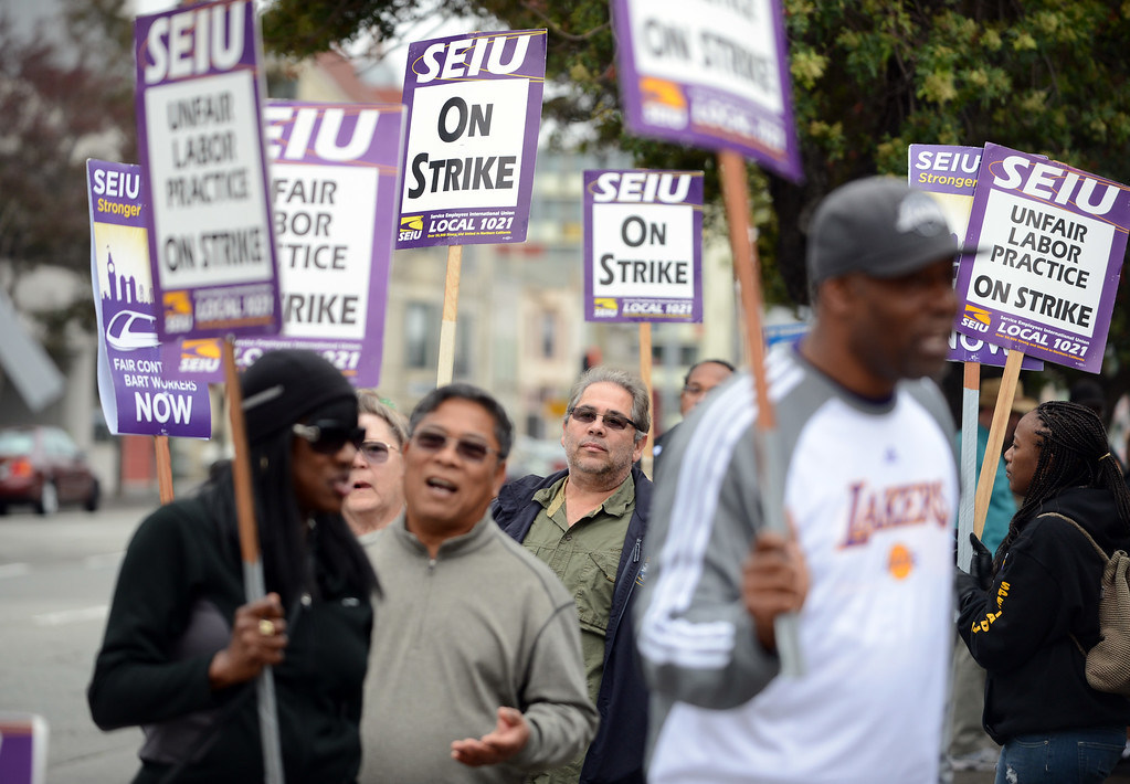 . Workers walk the picket line at the Lake Merritt BART station in Oakland, Calif., on Monday, Oct. 21, 2013. (Kristopher Skinner/Bay Area News Group)