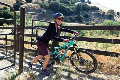 Lorraine Donovan, of Concord, walks past a gate before riding the trails at Crockett Hills Regional Park in Crockett, Calif., on Saturday, July 2, 2016. (Jose Carlos Fajardo/Bay Area News Group)
