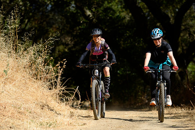 Amy Arth, of Pleasant Hill, rides with Kristin Maravilla, of Oakland, while riding the trails at Crockett Hills Regional Park in Crockett, Calif., on Saturday, July 2, 2016. (Jose Carlos Fajardo/Bay Area News Group)