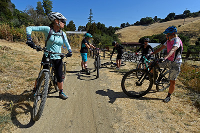 Nichole Kezsely, of Mill Valley, left, looks back as members of the group prepare to ride on the trails at Crockett Hills Regional Park in Crockett, Calif., on Saturday, July 2, 2016. The group is riding with the Bicycle Trails Council of the East Bay. (Jose Carlos Fajardo/Bay Area News Group)