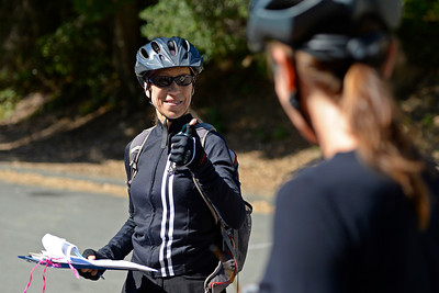 Amy Arth, of Pleasant Hill, with the Bicycle Trails Council of the East Bay gestures to riders before taking on the trails at Crockett Hills Regional Park in Crockett, Calif., on Saturday, July 2, 2016. (Jose Carlos Fajardo/Bay Area News Group)