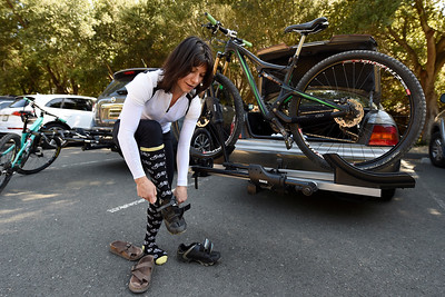 Lilia Zaiats, of Clayton, slips on her biking shoes before riding the trails at Crockett Hills Regional Park in Crockett, Calif., on Saturday, July 2, 2016. (Jose Carlos Fajardo/Bay Area News Group)
