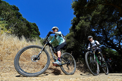 Nichole Kezsely, of Mill Valley, left, rides with Lilia Zaiats, of Clayton, on the trails at Crockett Hills Regional Park in Crockett, Calif., on Saturday, July 2, 2016. (Jose Carlos Fajardo/Bay Area News Group)