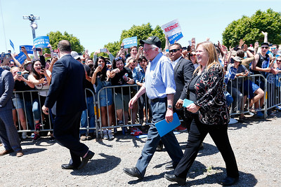 Bernie Sanders, Democratic presidential candidate, and his wife, Jane O'Meara Sanders, arrive to cheers during a rally at the Santa Clara County Fairgrounds in San Jose, Calif., on Wednesday, May 18, 2016. (Gary Reyes/Bay Area News Group)