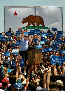 Bernie Sanders waves to the crowd alongside his wife Jane after Democratic presidential candidate delivered  a speech at the Santa Clara County Fairgrounds in San Jose, Calif., on Wednesday, May 18, 2016. (Karl Mondon/Bay Area News Group)