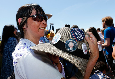 Susie Barton, of San Jose, shows off her Bernie buttons before the start of a rally for Democratic presidential candidate Bernie Sanders, at the Santa Clara County Fairgrounds in San Jose, Calif., on Wednesday, May 18, 2016. (Gary Reyes/Bay Area News Group)