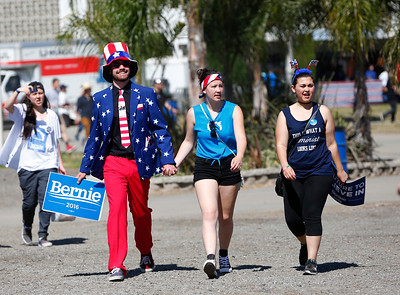 James Dineen, Sachi Taniguchi, Kristina Eehevarria, left to right, all from Monterey, walk into a Bernie Sanders rally at the Santa Clara County Fairgrounds in San Jose, Calif., on Wednesday, May 18, 2016.  (Gary Reyes/Bay Area News Group)