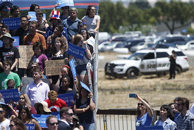 Sheriff deputies patrol in the parking lot behind Democratic presidential candidate Bernie Sanders rally at the Santa Clara County Fairgrounds Wednesday, May 18, 2016, in San Jose, Calif. (Karl Mondon/Bay Area News Group)