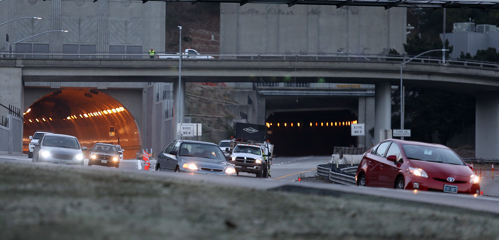 . Cars drive on highway 24 after passing through the fourth bore, left, of the Caldecott Tunnel after it was opened early Saturday, Nov. 16, 2013, in Orinda, Calif. (Ray Chavez/Staff)