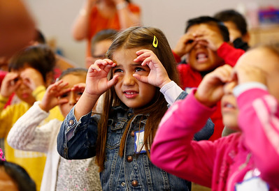 Helin Akgul puts on pretend glasses during a phonics lesson at a kickoff to kindergarten class at Sunnybrea Elementary School in San Mateo, Calif., on Thursday, July 7, 2016. The summer class helps students who are second-language learners, and those that have never been to preschool a chance to become better prepared before they enter kindergarten. (Gary Reyes/Bay Area News Group)