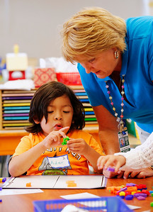 Teacher Beth Marsh helps Ader Reyes learn his letters during a kickoff to kindergarten class at Sunnybrea Elementary School in San Mateo, Calif., on Thursday, July 7, 2016. The summer class helps students who are second-language learners, and those that have never been to preschool a chance to become better prepared before they enter kindergarten. (Gary Reyes/Bay Area News Group)